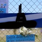 "A bouquet of flowers and banners in support of the 44 crew members of the missing at sea ARA San Juan submarine are placed on a fence outside an Argentine naval base in Mar del Plata, Argentina November 25, 2017. The banner below reads ""God, give strenght to the submariners"".  REUTERS/Marcos Brindicci"